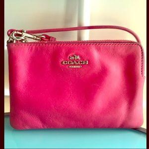 COACH pink leather corner zip wristlet